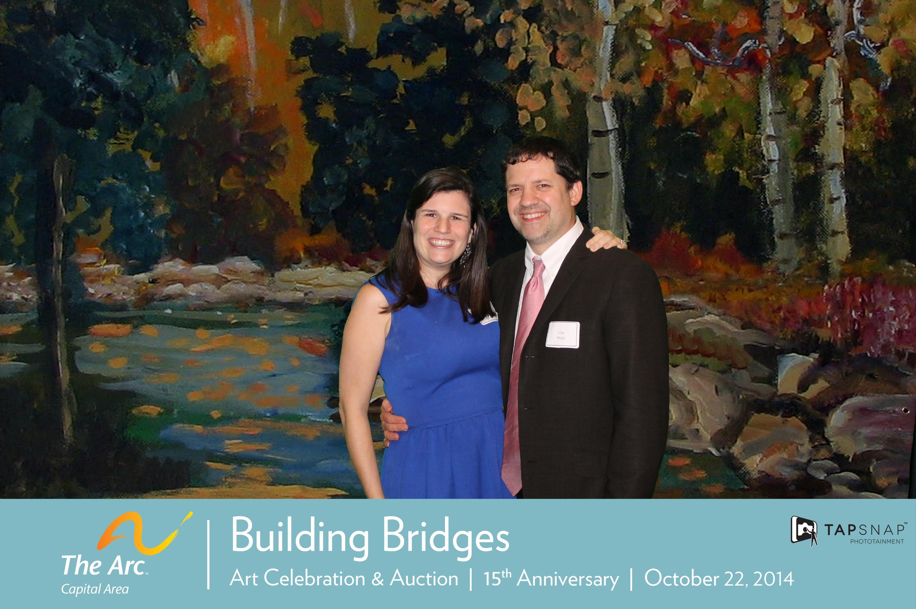 Laura Lee Daigle of LLB Designs with husband Clay at the 2014 Building Bridges Gala
